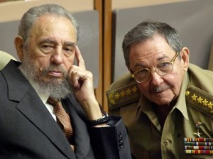 Fidel and brother, Raul (right)
