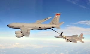 KC-135 refueling an F-15 in flight.