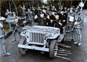 Elements of the Grand Fenwick military taking U.S. prisoners.
